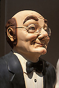 Humorous sculpture of a butler smiling