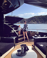 """Coco Rocha releases a photo on Instagram with the following caption: """"Feeling like Bond villains at sea! \ud83c\udf0a Outfit by @CynthiaRowley, yacht by @RobertoCavalli, epic day by @SylviaMantella!"""". Photo Credit: Instagram *** No USA Distribution *** For Editorial Use Only *** Not to be Published in Books or Photo Books ***  Please note: Fees charged by the agency are for the agency's services only, and do not, nor are they intended to, convey to the user any ownership of Copyright or License in the material. The agency does not claim any ownership including but not limited to Copyright or License in the attached material. By publishing this material you expressly agree to indemnify and to hold the agency and its directors, shareholders and employees harmless from any loss, claims, damages, demands, expenses (including legal fees), or any causes of action or allegation against the agency arising out of or connected in any way with publication of the material."""