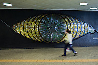 Shinjuku Eye by the artist Miyashita Yoshiko at the west exit of Shinjuku station since 1969..Although it is so eye-catching most people just rush by without paying attention to the huge piece of glass art.  Shinjuku Station serves as main connecting hub for rail traffic between central Tokyo and its western suburbs many railway and subway train lines.  The station is used by an average of 3.6 million people per day, making it the world's busiest transport hub with 36 platforms, an underground arcade, and over 200 exits.  .