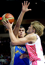 Maksym Pustozvonov of Ukraine vs Andrei Kirilenko of Russia during basketball match between National teams of Russia and Ukraine in Group D of Preliminary Round of Eurobasket Lithuania 2011, on August 31, 2011, in Arena Svyturio, Klaipeda, Lithuania. (Photo by Vid Ponikvar / Sportida)