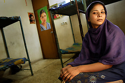 Maryam, 18, sits on her bunk at Dastak, a shelter opened in 1990 for abused women seeking refuge by the AGHA Legal Aid Cell, Lahore, Pakistan, May 2, 2005. Maryam is a rape victim who was jailed for seven months for having sexual intercourse. Her father married her off to a man and then accused him of rape as a revenge against him. For the last 10 months Maryam has lived at the shelter. She is now employed there as a cook and cleaner until she kind find a better alternative.