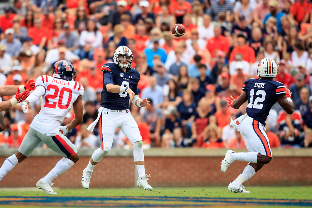 Auburn Tigers quarterback Jarrett Stidham (8) attempts a pass to wide receiver Eli Stove (12) during an NCAA football game against the Mississippi Rebels, Saturday, October 7, 2017, in Auburn, AL. Auburn won 44-23. (Paul Abell via Abell Images for Chick-fil-A Peach Bowl)