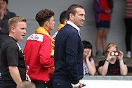 Newport manager Justn Edinburgh walks to his place at the dugout. Skybet football league two match, Newport county v AFC Wimbledon at Rodney Parade in Newport, South Wales on Saturday 27th Sept 2014<br /> pic by Mark Hawkins, Andrew Orchard sports photography.