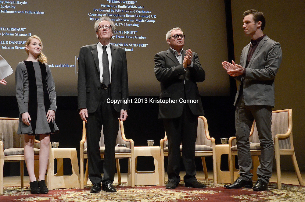 """WASHINGTON, DC - NOVEMBER 7: Geoffery Rush, Sophie Nelisse, Brian Percival, and Markus Zusak speak during the premiere of """"The Book Thief,"""" sponsored by the US Holocaust Museum at the United States Holocaust Memorial Museum on November 7, 2013 in Washington, DC. (Photo by Kris Connor/20th Century Fox)"""