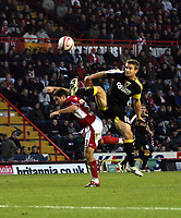 Photo: Mark Stephenson/Sportsbeat Images.<br /> Bristol City v Cardiff City. Coca Cola Championship. 15/12/2007.Cardiff's Paul Parry wins the ball from Lee Johnson