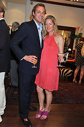 MAX KONIG and JULIET FETHERSTONHAUGH at a party to celebrate the launch of the new Mauritius Collection of jewellery by Forbes Mavros held at Patrick Mavros, 104-106 Fulham Road, London SW3 on 5th July 2011.