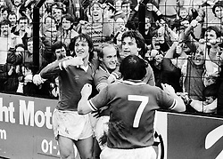 Leicester City's goalscorer Ian Wilson (centre) is congratulated by (L-R) Gary Lineker, Steve Lynex (No 7) and Alan Smith in front of jubilant Leicester City supporters. Leicester beat Fulham 1-0 at Craven Cottage.