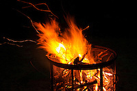 Evening camp fire in a free standing fire pit.