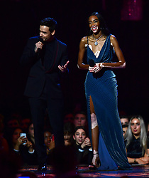 Winnie Harlow and Liam Payne on stage at the Brit Awards 2019 at the O2 Arena, London.