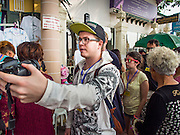 "15 OCTOBER 2014 - BANGKOK, THAILAND: A tourist takes a ""selfie"" with his camera while he walks down a Bangkok street. The number of tourists arriving in Thailand in July fell 10.9 per cent from a year earlier, according to data from the Department of Tourism. The drop in arrivals is being blamed on continued uncertainty about Thailand's political situation. The tourist sector accounts for about 10 per cent of the Thai economy and suffered its biggest drop in visitors in June - the first full month after the army took power on May 22. Arrivals for the year to date are down 10.7% over the same period last year.   PHOTO BY JACK KURTZ"