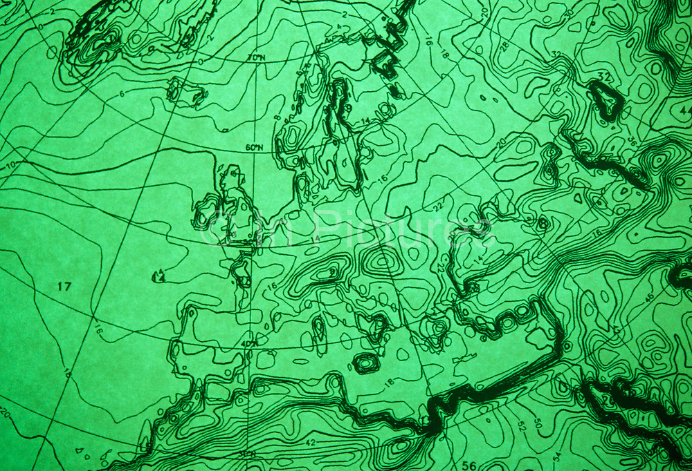 """A detail of a computerized weather chart showing atmospheric pressure isobars across western Europe on 16/9/91 at the European Centre for Medium-Range Weather Forecasts (ECMWF), Reading, UK. ECMWF  is an international organisation supported by 31 States, based in England, Belgium, Denmark, Germany, Greece, Spain, France, Ireland, Italy, Luxembourg, the Netherlands, Norway, Austria, Portugal, Switzerland, Finland, Sweden, Turkey, United Kingdom. Its role is """"to provide monthly and seasonal-to-interannual forecasts; to deliver real-time analyses and forecasts of atmospheric composition; to carry out climate monitoring through regular re-analyses of the Earth-system and to contribute towards the optimization of the Global Observing System."""" Source: http://www.ecmwf.int/"""
