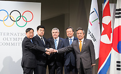 LAUSANNE, Jan. 20, 2018  Lee Hee-beom, president of the PyeongChang Organizing Committee for the 2018 Olympic and Paralympic Winter Games (POCOG), the Democratic People's Republic of Korea (DPRK)'s Olympic Committee President and Sports Minister Kim Il Guk, International Olympic Committee (IOC) President Thomas Bach, South Korea's Sports Minister Do Jong-hwan and South Korea's President of the National Olympic Committee (NOC) Lee Kee-heung (From L to R) shake hands during a ceremony after a four-party meeting at the IOC headquarters in Lausanne, Switzerland, Jan. 20, 2018. (Credit Image: © Xu Jinquan/Xinhua via ZUMA Wire)
