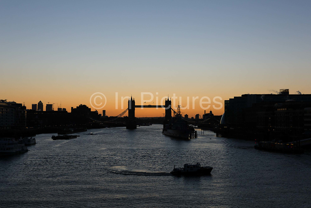 Clear and cold sky shortly before sunrise is seen behind Tower Bridge on the River Thames in London, England on February 12, 2018 following a very cold night in the capital with temperatures dropping to below zero degrees in some area of the city.