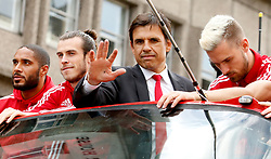File photo dated 08-07-2016 of Wales' Ashley Williams, Gareth Bale and Aaron Ramsey with manager Chris Coleman on a open top bus during the Euro 2016 homecoming in Cardiff City centre. Issue date: Tuesday June 1, 2021.