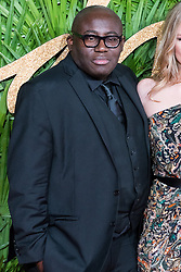 © Licensed to London News Pictures. 04/12/2017. London, UK. British Vogue magazine editor EDWARD ENNINFUL arrives for The Fashion Awards 2017 held at the Royal Albert Hall. Photo credit: Ray Tang/LNP