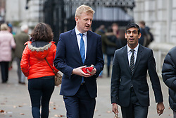 London, UK. 6th December, 2018. Oliver Dowden (l), Conservative MP for Hertsmere, and Rishi Sunak (r), Conservative MP for Richmond (Yorks), arrive during a Privy Council meeting at the Cabinet Office.