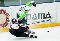 Mei Ushu of Japan vs Miha Verlic of Slovenia during ice-hockey friendly match between National teams of Slovenia and Japan, on April 10, 2015 in Arena Podmezakla, Jesenice, Slovenia. Photo by Vid Ponikvar / Sportida