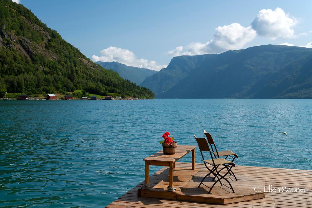 Two chairs on a dock on Lustra Fjord, Solvorn, Vestlandet, Norway
