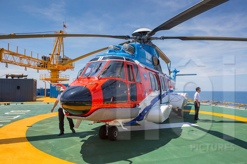Helicopter on an oil rig offshore of Vung Tau, Vietnam, Southeast Asia
