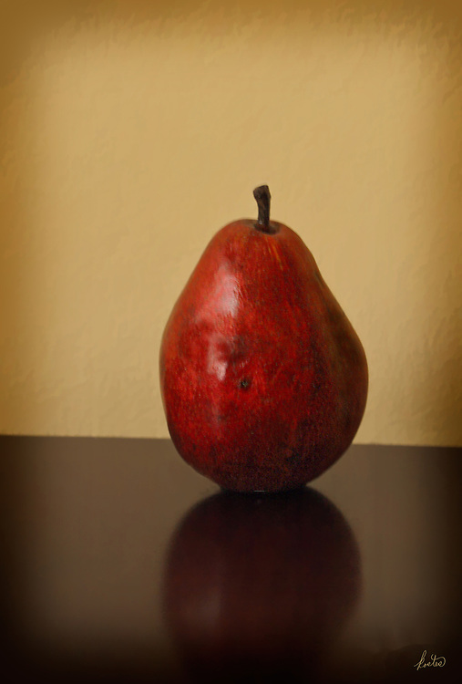 Still life with a red pear.