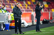 Middlesbrough manager Neil Warnock applies lip balm as Brentford manager Thomas Frank has a drink during the EFL Sky Bet Championship match between Brentford and Middlesbrough at Brentford Community Stadium, Brentford, England on 7 November 2020.