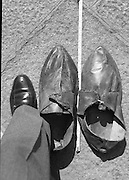 Shoes Of The Tallest Man In Ireland.    (R61)..1987..22.07.1987..07.22.1987..22nd July 1987..In 1985 Shaun Aisbitt from Ballybough in Dublin was declared to be the tallest man in Ireland. His shoe size was said to be size 22. A waxwork of Shaun was displayed in Dublin's Waxwork Museum. The shoes are on display in The Dublin Civic Museum in South William Street, Dublin...Image shows the shoe size comparison of a size 22 against a size 11.