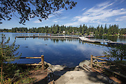 Pine Lake Park, along picturesque Pine Lake in Sammamish, is popular among families for its large play area and ball fields, plus its beach and docks, which are especially popular among local fishermen. (Steve Ringman/The Seattle Times)