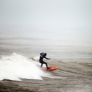 """Aurelien finds himself on top of a wave outside of Seabreeze NY. """"The preparation is huge, I mean the first thing… it is very mental because it is crazy."""""""
