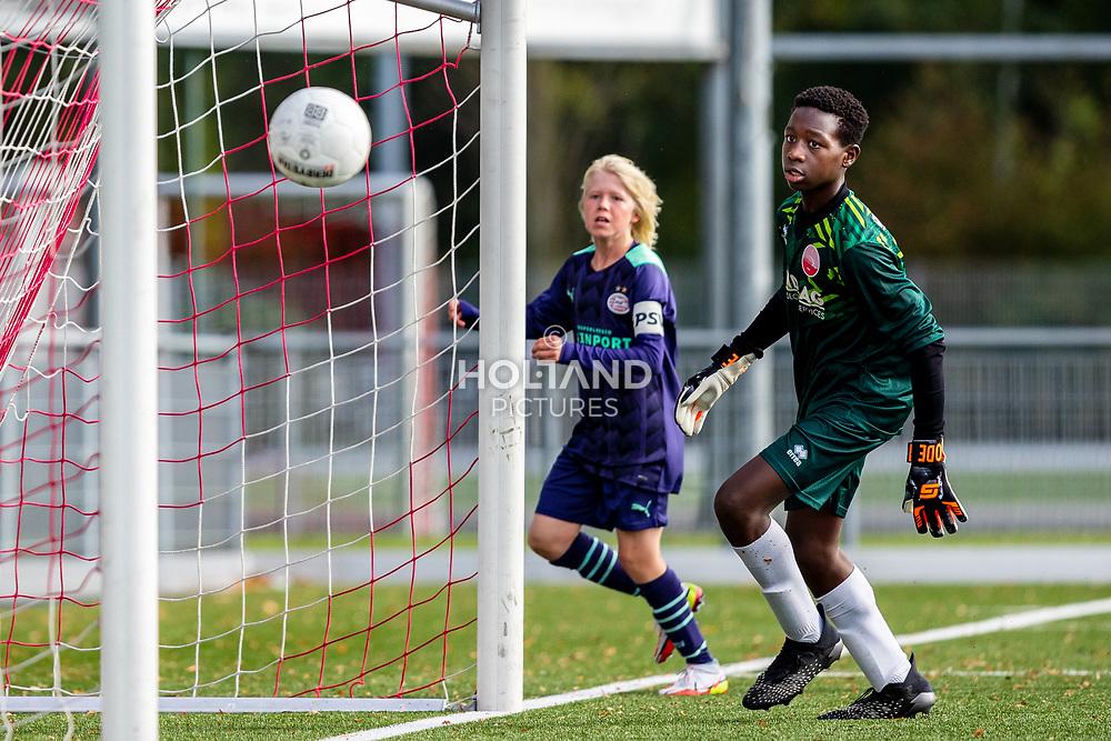 ALPHEN AAN DEN RIJN, NETHERLANDS - OCTOBER 2: (L-R) #7 Isai Middag (PSV), #1 Tyron Chaar (Alphense Boys) during the Divisie 1 A NAJAAR u15 match between Alphense Boys and PSV at Sportpark De Bijlen on October 2, 2021 in Alphen aan den Rijn, Netherlands