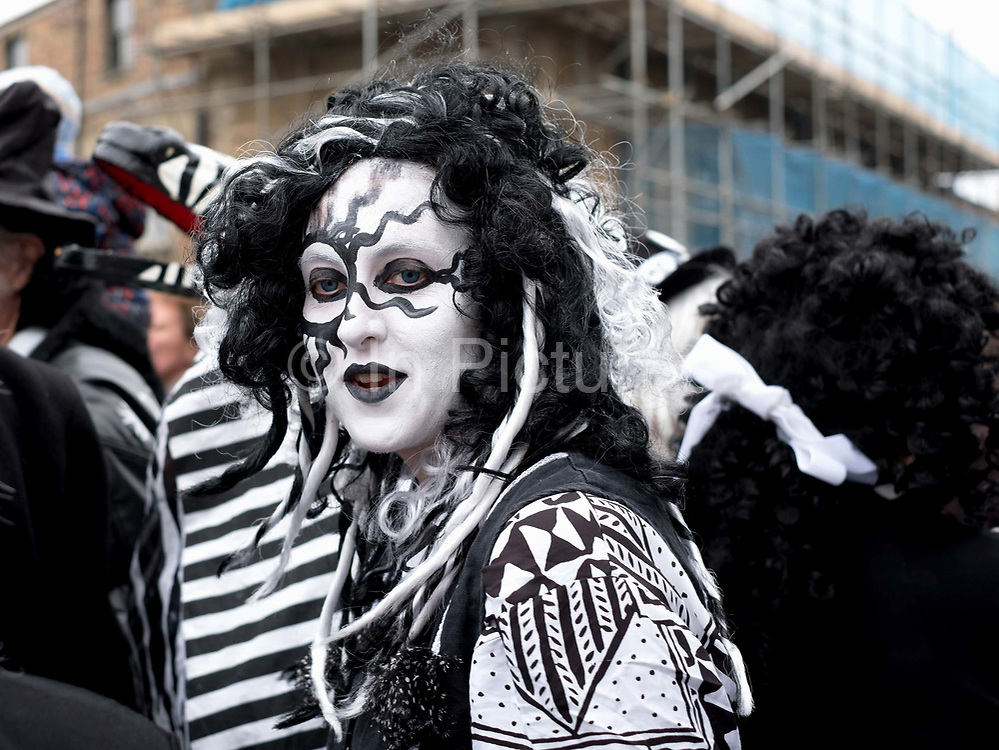 Pig Dyke Molly performer at the Straw Bear Festival in Whittlesey near Peterborough, United Kingdom on 13th January 2018. The traditional event was revived in 1980 and features a Straw Bear and its children being led through the streets of Whittlesey. The bear dances, while musicians break off into groups around the town square to perform with many different Morris, Molly, Sword, Mummer and Appalachian dancing teams