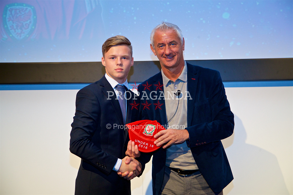 NEWPORT, WALES - Saturday, May 27, 2017: Daniel Griffiths receives his Under-16 Wales cap from Wales' Elite Performance Director Ian Rush at the Celtic Manor Resort. (Pic by David Rawcliffe/Propaganda)