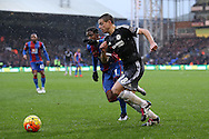 Cesar Azpilicueta of Chelsea goes past Wilfried Zaha of Crystal Palace. Barclays Premier League match, Crystal Palace v Chelsea at Selhurst Park in London on Sunday 3rd Jan 2016. pic by John Patrick Fletcher, Andrew Orchard sports photography.