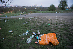 © Licensed to London News Pictures. 05/04/2021. London, UK. Litter strewn across the hillside of Primrose Hill in north London, the morning after revellers took to the picturesque location to enjoy the warm spring weather. A relaxation of some lockdown restrictions has gathered larger crowds in many outdoor spaces. Photo credit: Ben Cawthra/LNP