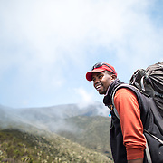 A guide in the heath zone on Mt Kilimanjaro's Lemosho Trail at about 10,000 feet.