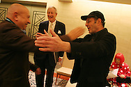 French sculptor Christian Boltanski (left) greets American musician Steve Reich( wearing hat) whilst behind them sits Japanese artist Yoyoi Kusama (in red), prior to a press conference for the 2006 Praemium Imperiale art awards, of which all are Laureates, in the Hotel Okura, Tokyo, Japan, on Tuesday, Oct. 17,  2006. The five laureates in 2006 were internationally renowned  Japanese artist Kusama Yayoi, French sculptor Christian Boltanski, German architect Frei Otto, American musician Steve Reich, and Russian dancer ballerina Maya Plisetskaya. All receive an honorarium of 15 million Yen, and a medal. The Japan Art Association is the oldest cultural foundation in Japan, established in 1887. The laureates are chosen each year by an international jury, from a list of nominees put forward by advisors. The awards are held annually in Tokyo in the presence of Prince and Princess Hitachi.