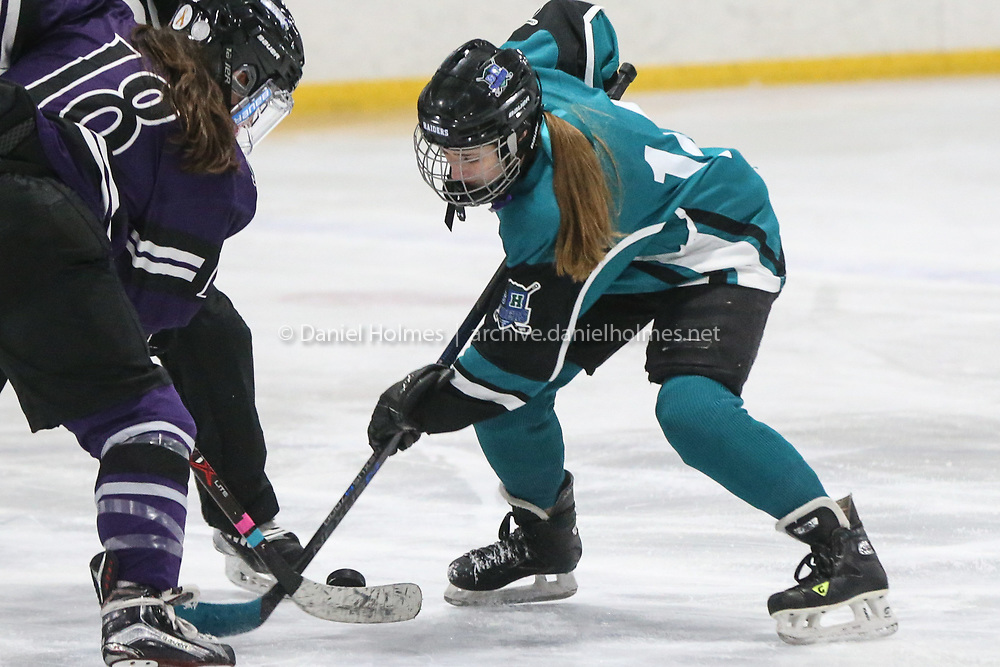 (1/25/20, HOPEDALE, MA) Dover-Sherborn/Hopkinton's Julia MacDonald faces off during the Stick it to Cancer fundraising hockey game against St. Peter Marian at Blackstone Valley IcePlex in Hopedale on Saturday. [Daily News and Wicked Local Photo/Dan Holmes]