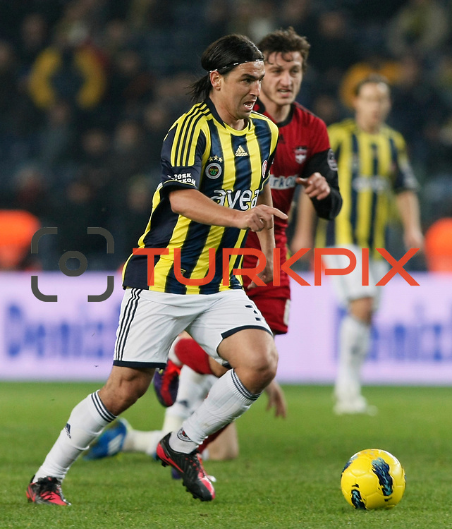 Fenerbahce's Mehmet Topuz (L) during their Turkish superleague soccer match Fenerbahce between Gaziantepspor at the Sukru Saracaoglu stadium in Istanbul Turkey on Monday09 January 2011. Photo by TURKPIX