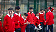 Young boys prepare to play cricket at St Paul's Way Trust School, Bow, East London. Fewer than 10% of pupils speak English as their first language and 85% are of Bangladeshi origin at the school.