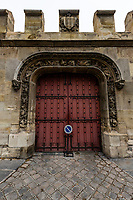 Ornate Paris Door at Cluny - Thousands of doors and gates adorn buildings in Paris.  Some of the best are on government offices, cathedrals and churches, as well as a few chateau.  However, any self-respecting contractor with a decent budget probably spent a lot of consideration in installing suitable doors, windows, grill work and even doorknobs. Some of these gates, doors and windows are very simple, while others are extravagant works of art. The styles of these doors tell about the history of France. As you walk across the 20 arrondissements of Paris, you will discover Gothic, Renaissance, Haussmann and Art Nouveau door styles. It is up to you to take the time to look for little details of these Paris' most beautiful doors with statues, bas-reliefs, mascarons, gold-leaf, grills, handles and door knobs.