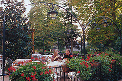Europe, Italy, Tuscany, couple having coffee in garden at monastery