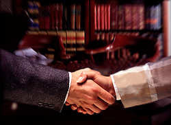 Male female shake hands in lawyers business office. CONCEPT STOCK PHOTOS