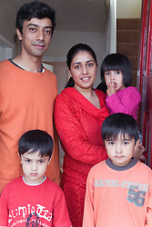 Young family on their doorstep,