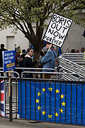 A male remainer holds a placard saying Boris Out Now And Forever outside Houses of Parliament on the first day after summer recess on 3rd September 2019 in London in the United Kingdom. MPs return to Westminster for a Brexit shutdown that could result in a general election.