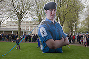 As families queue in the grounds of the Naval College, Greenwich, children play beneath a giant inflatable figure of a Royal Navy sailor. During a public open-day in Greenwich, London when the Royal Navy's aircraft carrier HMS Illustrious docked on the river Thames, allowing the tax-paying public to tour its decks before its decommisioning. Navy personnel helped with the PR event over the May weekend, historically the home of Britain's naval fleet.