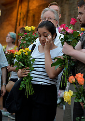A women shows her emotion as she joins members of the public, gathered close to Finsbury Park Mosque in north London, after a van was driven into pedestrians near the north London mosque, leaving one man dead and eight injured.