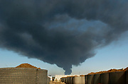 Smoke rises in the sky above Forward Operating Base Warrior in Kirkuk Monday, Feb. 14, 2005. The plume is from an attack on an oil pipeline. Warrior is the home of the 3rd Battalion, 116th Cavalry of the Oregon Army National Guard.  Photo by Randy L. Rasmussen/The Oregonian