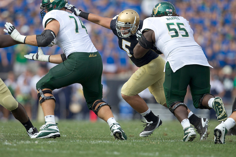 South Florida linebacker Michael Lanaris (#55) blocks Notre Dame inside linebacker Manti Te'o (#5) in action during NCAA football game between Notre Dame and South Florida.  The South Florida Bulls lead the Notre Dame Fighting Irish 16-0 at halftime in game at Notre Dame Stadium in South Bend, Indiana.  The game has been delayed due to rain storms and lightning in the area.
