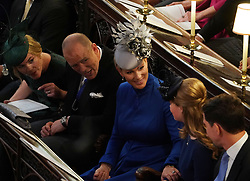 Summer Phillips, Mike Tindall, Zara Tindall and Lady Louise Mountbatten-Windsor at the wedding of Princess Eugenie to Jack Brooksbank at St George's Chapel in Windsor Castle.