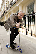 Alexander Lebedev on his scooter outside the Haymarket Hotel in London  before his interview with Welt am Sonntag. 14th April 2009 <br /> <br /> Tel 0044(0)208 944 6933<br /> www.linkphotographers.com Photography by Orde Eliason