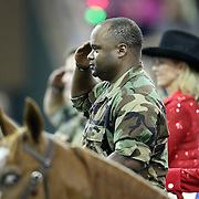 A member of the Horses and Heroes team salutes the American Flag  during the 129th performance of the PRCA Silver Spurs Rodeo at the Silver Spurs Arena   on Friday, June 1, 2012 in Kissimmee, Florida. (AP Photo/Alex Menendez) Silver Spurs rodeo action in Kissimee, Florida. PRCA rodeo event in Florida. The 129th annual running of the cowboy event.